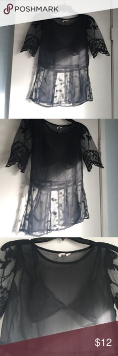 Mesh see through top This mega cute black see through mesh top can be so cute paired in so many ways. By itself with a cute bralette as pictured or underneath a dress or romper. The sleeves are my favorite with the scalloped edges and flower detail. Tag says XS but honestly fits a small or even medium Frenchi Tops Tees - Short Sleeve