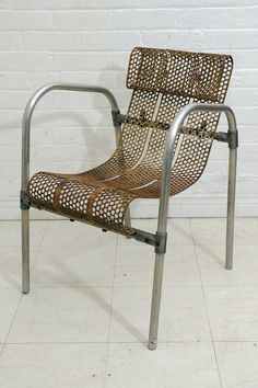 Adrien Claude; Tubular Aluminum and Enameled Perforated Steel Armchair for Meubles Artistiques Modernes France, c1945.