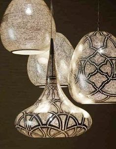 Love these silver pounded punched metal pendant lights from Dutch furniture company Zenza. Just the right amount of luster on these hanging lights...not too silver and shiny and not to matte. Modern Moroccan in style.
