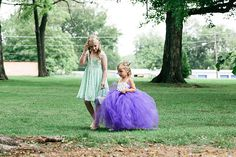 Flower girls in colors to match the flowers! Shop these flower girl dresses and more at shopmrmrs.com, a gallery of real & shoppable wedding photos.