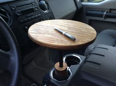 Make a DIY Mini Table in Your Vehicle - http://www.diyave.com/make-a-diy-mini-table-in-your-vehicle/