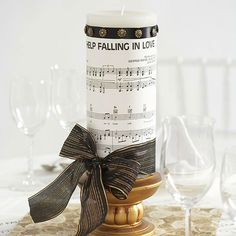 Use sheet music that is special to you and your loved ones for a gorgeous centerpiece: http://www.bhg.com/wedding/centerpieces/easy-to-make-wedding-centerpieces/?socsrc=bhgpin071814sheetmusiccenterpiece&page=5