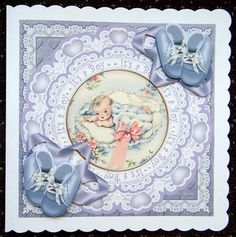 """Baby Boy Its a Boy 7in Doily Decoupage Topper on Craftsuprint designed by Ann-marie Vaux - made by Giselle Topper - Fell in love with this sheet too. After printing the sheet and cutting out the elements - I mounted the decourpage pieces with foam tape. I then adhered the base topper onto a Crafty Bob's white scalloped edge card base. Finally adding a number of two dots between the """"It's a boy"""" wording to finish off. I just love it. Why not take a look at other cards I have crafted on my ..."""
