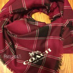 SALE Shawl Scarf  100% Authentic Coach Shawl Scarf with fringe. Multi check plaid cranberry color. Material: 100% Wool. No trades or PP. REASONABLE OFFERS ARE WELCOME  MSRP: $150 + Tax COMES WITH COACH GIFT BOX. NOTE: Last picture is not mine.  Coach Accessories Scarves & Wraps