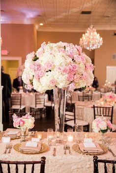 Tall floral pieces and sequin linens can add some visual interest to your reception room, making your head table unique! Love this blush, cream and champagne color scheme - soft and romantic.  Photo by Amy Karp Photography, Floral by Petals Couture, Linens from La Tavola Fine Linen, Reception Venue - Grand Hotel in McKinney.