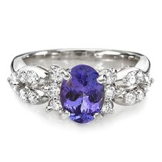 Tanzanite and diamond engagement ring. I already have a ring, but Lucas wants to get me a different one... I'd be totally okay with tanzanite!