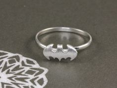 http://www.hellomissapple.com/collections/rings/products/batman-ring