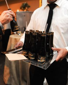 Mini bottles of Champagne were given to guests as they entered the reception.