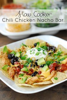 Crock Pot recipes are perfect for the holidays! This Slow Cooker Chili Chicken Nacho Bar is easy to make and can be served at a holiday party.