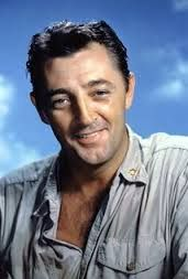 """Robert Mitchum -- (8/6/1917-7/1/1997). American Film Actor, Director, Author, Composer & Singer. He portrayed Sam Dutton on TV Series """"African Skies"""". Movies -- """"Out of the Past"""" as Jeff, """"The Night of the Hunter"""" as Harry Powell, """"Ryan's Daughter"""" as Charles Shaughnessy, """"Midway"""" as Admiral William F. Halsey, """"Matilda"""" as Duke Parkhurst, """"Cape Fear"""" as Lieutenant Elgart, """"The Sunset Boys"""" as Ernest Bogan. He died due to Complications of Lung Cancer & Emphysema, age 79."""