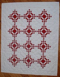 Two-Color Quilt Striking yet an easy pattern. If I made this, I would need to add a border with the red. It needs balance on the outer edges.