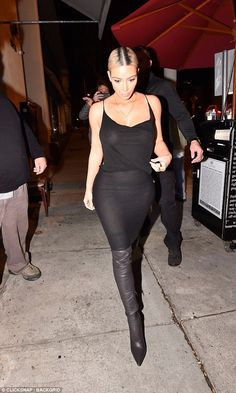 Fancy: Kim paired the racy look with thigh high point boots in a dark tone