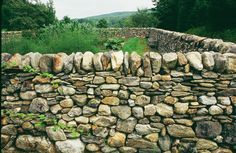 Dry stone walls are built without mortar, using techniques that are almost as old as humankind. Basically, you stack stones together, shimming and packing them to balance their weight and position. Although that sounds simple -- and in many ways it is -- building dry stone walls is not without challenges.Stone is heavy, and working with it requires...