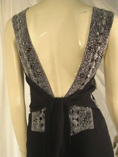 1930s Black Crepe Gown w/ Beading Attributed to Patou | From a collection of rare vintage evening dresses at http://www.1stdibs.com/fashion/clothing/evening-dresses/