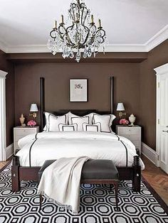 Love this bedroom!  Go glam: Paint walls chocolate brown, trim and night tables high-gloss white. Behr's Premium Plus in Revival Mahogany,