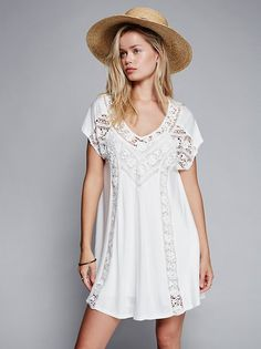 FP X Caraway Mini Dress | Easy and flowy mini dress featuring floral crochet detailing throughout. V-neckline with cutout detailing in back. Lined.