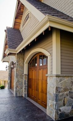 Gorgeous wooden garage door with tan accents on exterior