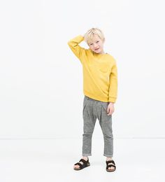 PLEATED TROUSERS WITH POCKETS