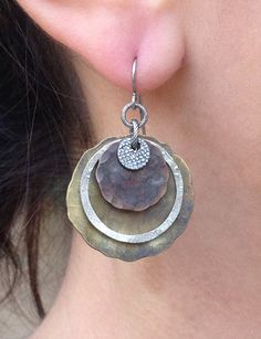 Multi metal textured earrings. $40.00, via Etsy.