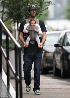 David Schwimmer- I love how he is holding the baby's feet! awwww