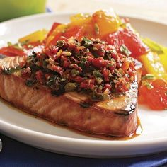 This Mediterranean-inspired relish pairs nicely with most grilled fish, so if tuna isn't your favorite, substitute salmon, halibut, or swordfish steaks. For a shortcut, pulse the tomatoes and olives a few times in a food processor and then add the remaining ingredients and pulse to combine.