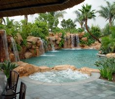 Gorgeous pool with rock waterfalls. A dream of mine.