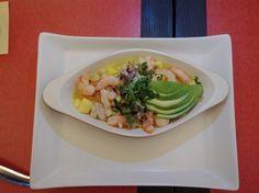 """Ceviche """"Doña Ines"""" Un platillo muy tropical con pescado, camarón, mango,pepino,chile manzano, cebolla morada y cilantro."""
