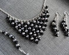 This is a beautiful handmade necklace earrings and bracelet set. The earrings are made with sterling silver French hooks. The Earrings are inches long. The bracelet is 8 inches long. The Necklace is 26 inches long. Diy Necklace, Crystal Necklace, Beaded Jewelry Patterns, Beading Patterns, Bead Jewellery, Wire Jewelry, Bridal Jewelry Sets, Beads And Wire, Silver Glitter
