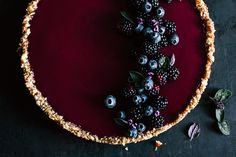 A refreshing cake loaded with a bunch of dark berries.