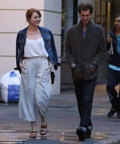 Together again? Despite saying their Autumnal break-up was definitive, Emma Stone and Andrew Garfield looked delighted to be in each other's company again on Sunday