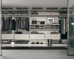 Spacious Walk In CLOSETS Equipped With Marble Flooring Unit And Glass Sliding Door Design With Metal Frame Idea