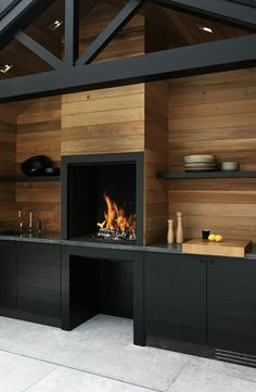 The natural wood mixed with the dark finish. Wood burning fire doubles up as oven.