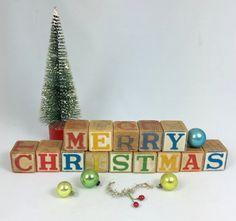 Wooden vintage alphabet baby blocks spells Merry Christmas 14 stacking blocks Christmas decor from MilkweedVintageHome by MilkweedVintageHome on Etsy