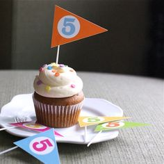 I love the bright, simple, fun style of these printable pennant cupcake toppers from Rachel at Fog and Thistle.