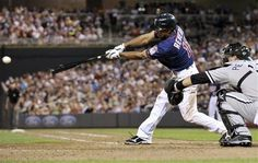 Minnesota Twins' Ben Revere hits a single in the eighth inning of a baseball game against the Chicago White Sox, Monday, June 25, 2012, in Minneapolis. Revere went 4-for-5 in the Twins' 4-1 win
