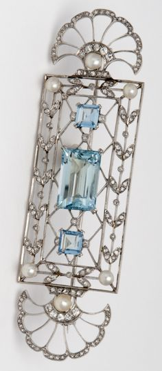 GEORGES FOUQUET - An Art Deco platinum, diamond, natural pearl and aquamarine brooch, circa 1925. #Fouquet #ArtDeco #brooch