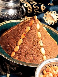 Sellou is a unique Moroccan sweet made from sesames, almonds and flour that has been browned in the oven. It is traditionally served in Ramadan and for special occasions.