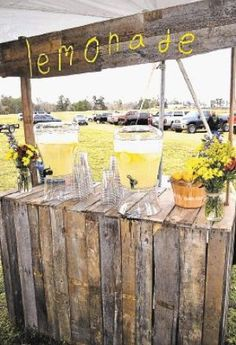 Rustic lemonade stand for an outdoor reception. What a cute and different way to set up your refreshment table!