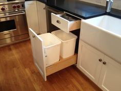 Chef's kitchen in 1920s Portland home Storage solutions: compost drawer and pull-out for garbage and recycling Brushed (satin) nickel pulls