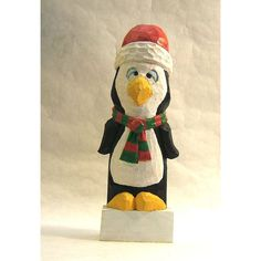 Santa Penguin Wood Carving Art Sculpture Figurine ($36) ❤ liked on Polyvore featuring home, home decor, wooden figurines, wood home decor, penguin figurines, wooden figure and wooden sculptures