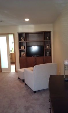 CUSTOM TV UNIT- new master bedroom suite. utilized a closet into a custom tv, storage, display area