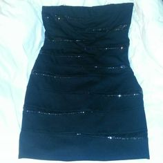 DRESS Black dress with black sequin. Has been worn a few times fits really nice it is missing the straps , and the tread is fraying which is causing the lining to separate by the top right area of the dress. Its has a side zipper, and has support to be able to wear strapless. Made of 60% rayon 35% nylon 5% spandex no stains INC International Concepts Dresses Mini
