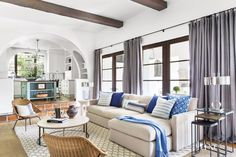 Chic touches and bold details breathe stylish new life into a fashion-savvy family's classic Spanish Colonial-style Beverly Hills home.
