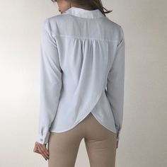 """• Last Item • Baby Blue Split Blouse L The perfect classic blouse with a twist. Features a split open back in a gorgeous light baby blue. You can't go wrong with this chic blouse. Features a single pocket on the chest. Non sheer & an amazing quality. A must have staple. Size M measures 20"""" across chest 26"""" in length. 100% Poly. For size reference I am wearing Size S and 5'3"""" Size 0/2* Please do not purchase this listing- Thank you! Boutique Tops Blouses"""