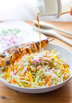 Chicken Satay Salad: crunchy veggies tossed in a sweet and spicy peanut-ginger sauce, and topped with grilled peanut-ginger chicken.