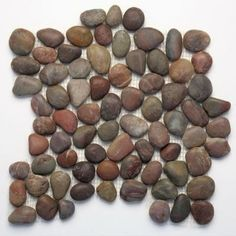 Natural Stone Pebble Mosaic - How about adding real stones to your backsplash? Earthy, textural, neutral, and fun, this rustic element just keeps gaining popularity.