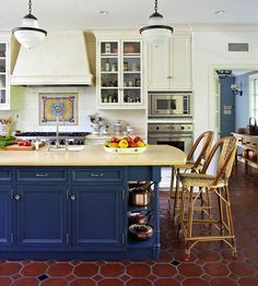 Paint existing cabinets this lovely dark blue to add drama {and get rid of overdone builder grade oak}.