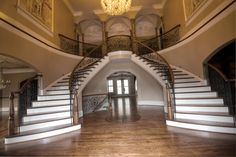 Image Design Stairs Twin curved stairs with custom handrail and metal balusters