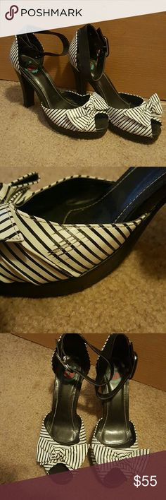 Peeptoe Spectators Adorable black & white platform heels with sexy ankle straps.  Perfect for spring events and they go with almost any dress.  Worn once for Ky Derby 2014.  They do have a couple of scuffs and they are shown in the photos TUK Shoes Platforms