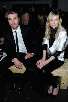 Kirsten Dunst and Garrett Hedlund sat front row at the Saint Laurent runway show on Monday!